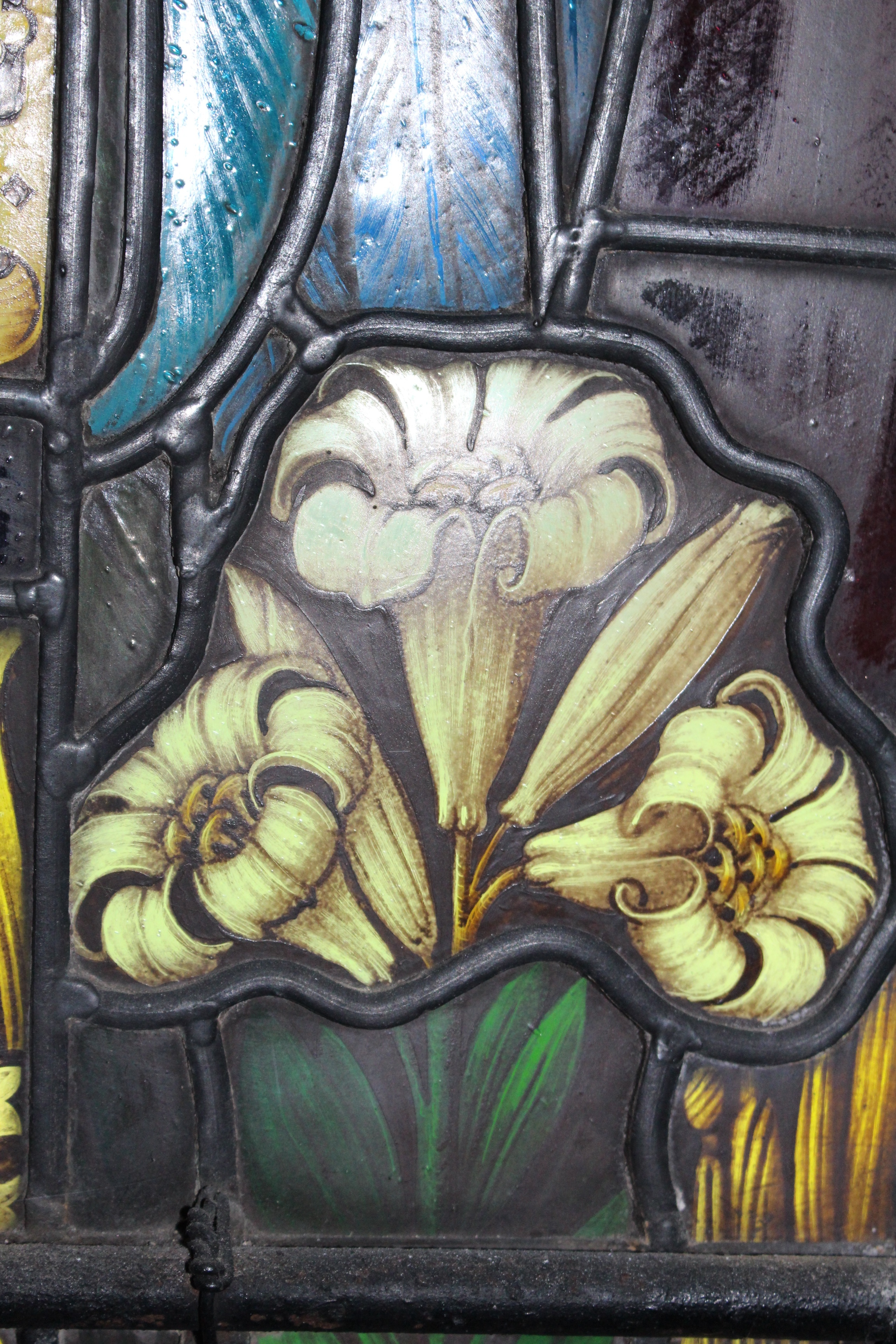 Detail of lilies at the feet of the Archangel Gabriel